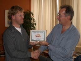 Adriaan (left) receives the Zimbu Award from Bram